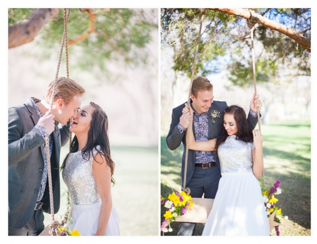 married couple pose with tree swing for wedding photos