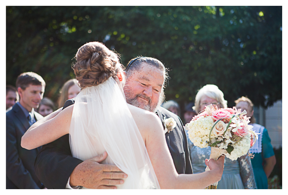 bride hugs dad at grand America wedding